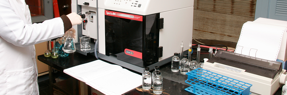 A scientist analyzes a sample using Atomic Absorption spectroscopy
