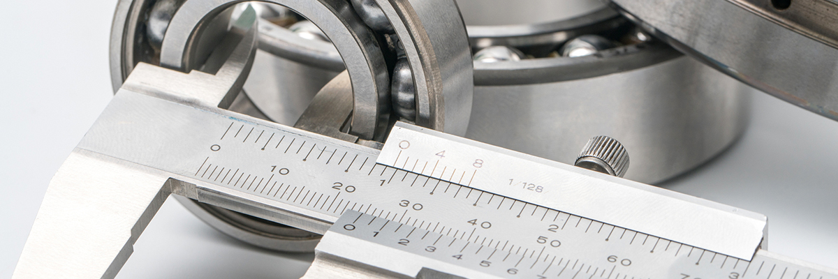 Using calipers to measure a component