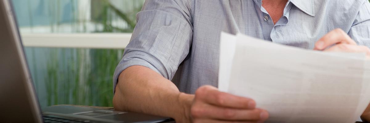 A man reading printouts